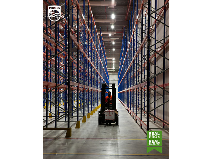 A forkliftruck in an empty stockroom warehouse
