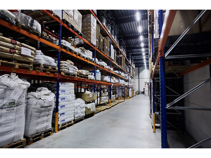 Application picture of MASTER LEDtube. Industrial storage with pallets with product in the shelves.