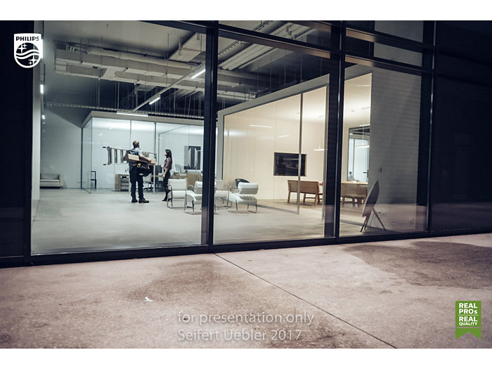 Office areas: furniture and people behind a glass window