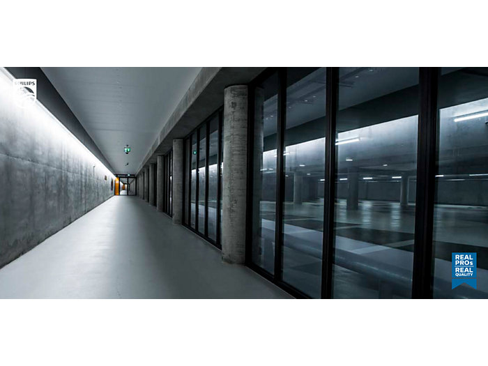 Glass hallways with sensor lights during the evening