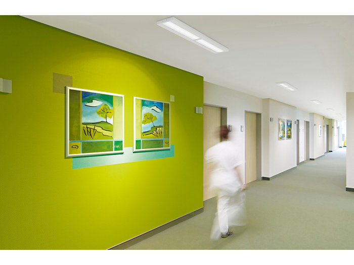 CoreLine surface-mounted luminaire in use in a corridor of a green and white corridor