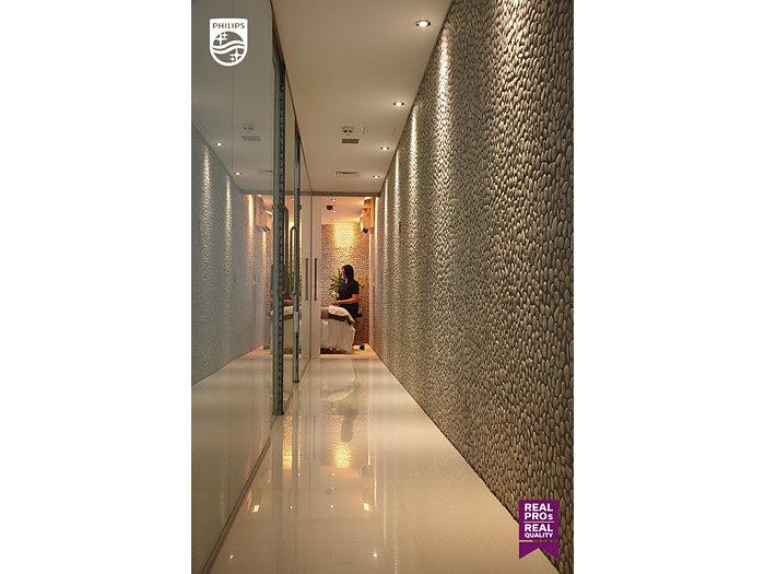 A woman in a hotel hallway