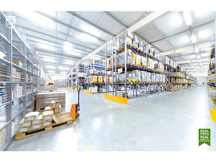 Forkliftruck in a warehouse stockroom with pallets